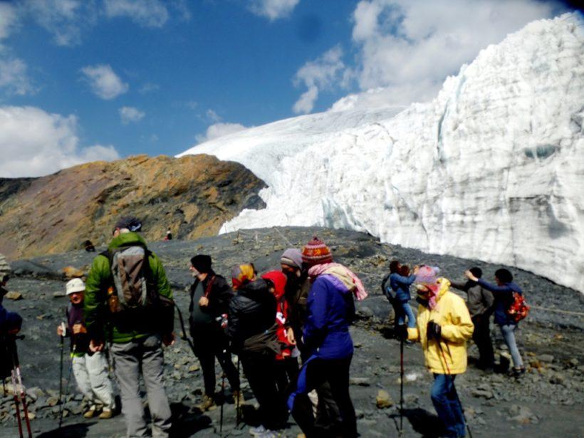 Tourists very close to the glacier
